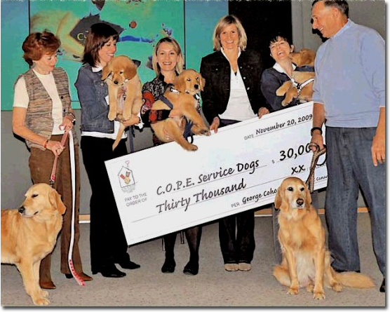 Image McDonald's Childrens Charity Donation to COPE Service Dogs